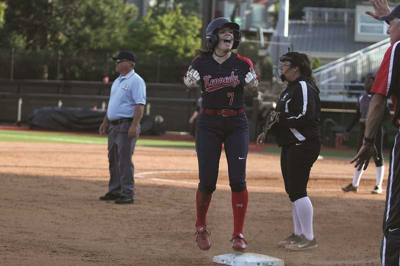 PMG PHOTO: PHIL HAWKINS - Kennedy sophomore Ellie Cantu celebrates after reaching third base safely on a deep triple that scored teammate Emily Cuff in the fifth inning.
