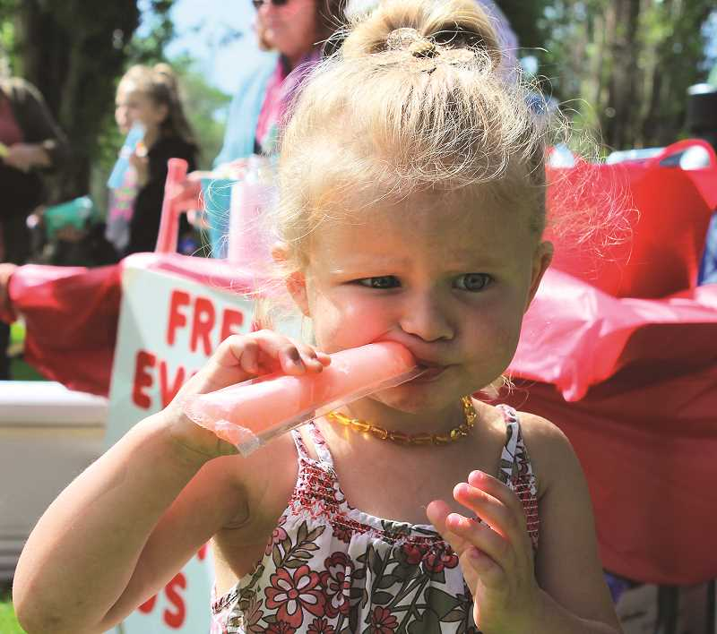 HOLLY SCHOLZ/CENTRAL OREGONIAN  - Huntley Faller, age 2 ½, munches on her Otter Pop during the event.