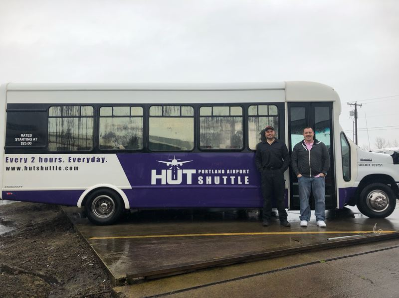SUBMITTED PHOTO - Hut Shuttle drivers are ready to pick up passengers for a run to Portland Airport from Oregon City's Best Western Plus Rivershore Hotel.