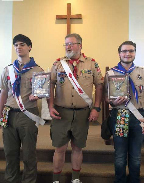 COURTESY PHOTO: JEFF HAMMOCK - Donald Hammock (left) and Justin Derrick (right) receive troop plaques from Scoutmaster Gary Dumolt.