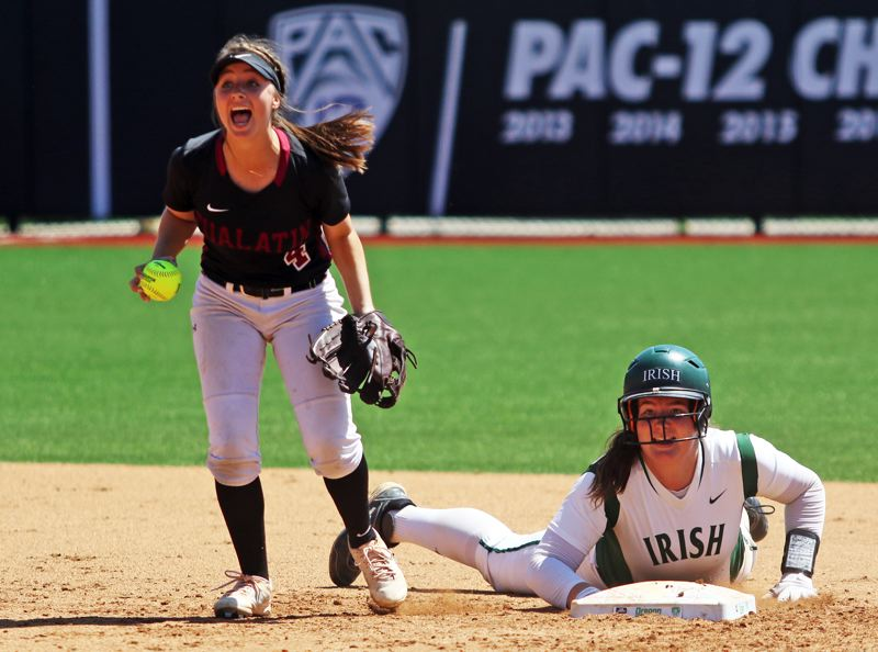 PMG PHOTO: DAN BROOD - Tualatin junior shortstop Bella Valdes (left) yells after tagging out Sheldon's Emma Neuman at second base during Saturday's Class 6A state championship game.