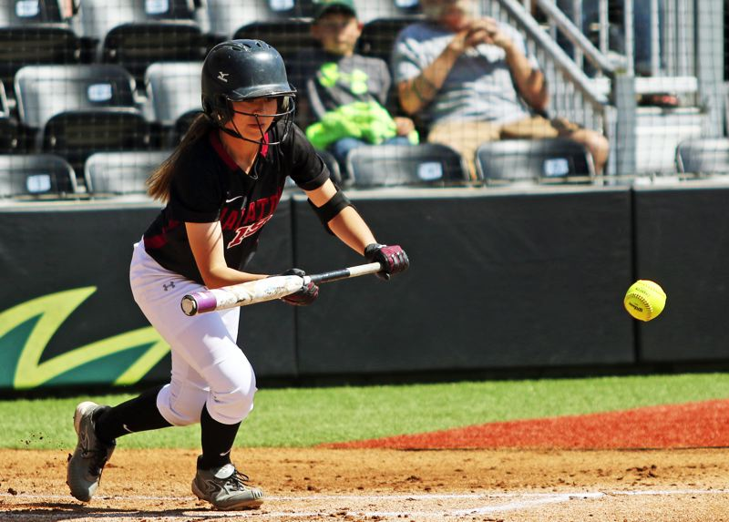 PMG PHOTO: DAN BROOD - Tualatin High School senior Andrea Gomez puts down a sacrifice bunt in the first inning of Saturday's Class 6A state championship softball game.
