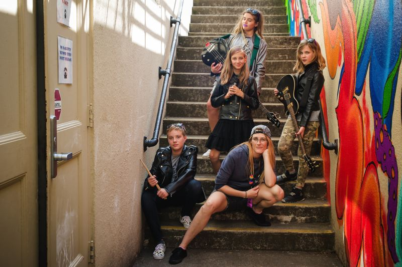 COURTESY: RNRC4G - The Rock 'N' Roll Camp for Girls, which hopes to land a permanent home with Rose City Rollers, helps girls and teenagers with all aspects of being in a band, including posing for a publicity photo (above). A potential partnership and space would allow bands to stay together, says Kristi Balzer, the group's executive director.