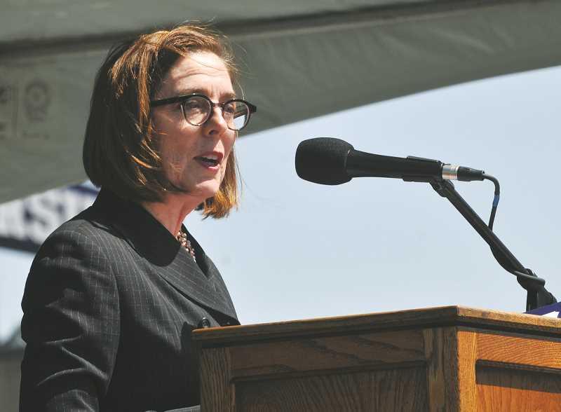 GRAPHIC PHOTO: GARY ALLEN - Gov. Kate Brown recounted her experiences with Ken Austin Jr., particularly the pair's involvement with Special Olympics Oregon.