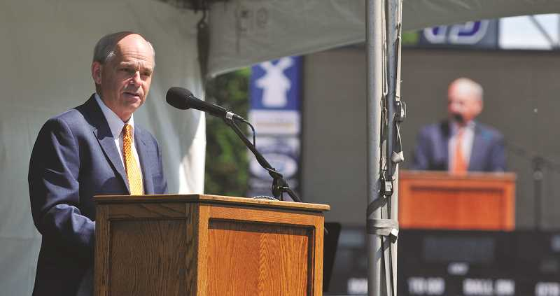 GRAPHIC PHOTO: GARY ALLEN - Oregon Historical Society Executive Director Kerry Tymchuk addresses the hundreds who attended a celebration of life for Ken Austin Jr. Friday at George Fox University.