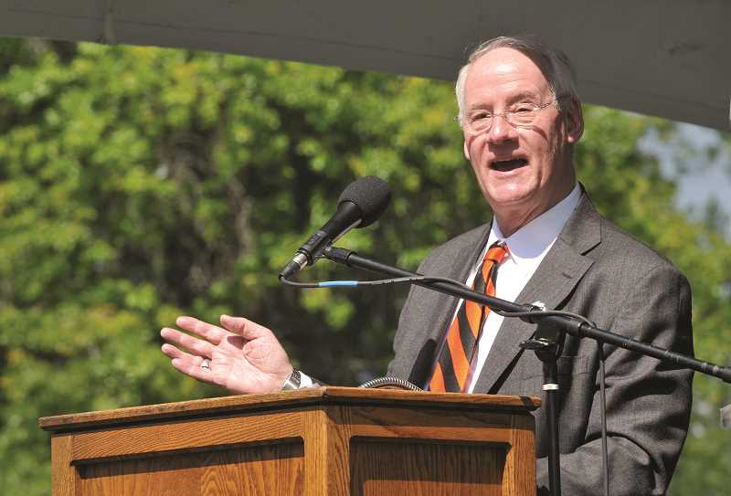 GRAPHIC PHOTO: GARY ALLEN - Oregon State University President Ed Ray recounts Ken Austin Jr.'s contributions to his alma mater, as well as some of the more lighter moments the pair shared over the years.