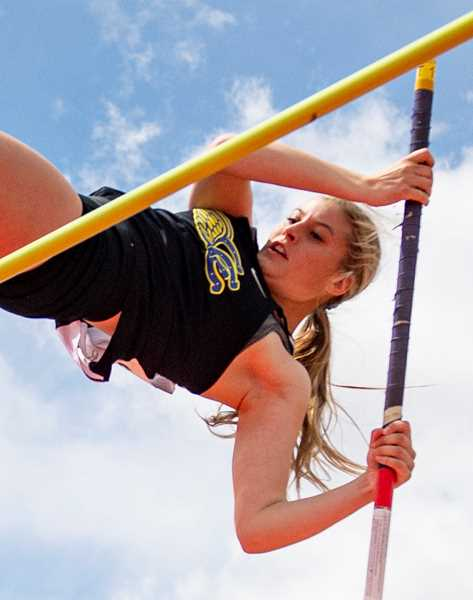 LON AUSTIN/CENTRAL OREGONIAN - Faith Wagner, who holds the Crook County High School girls pole vault record, competes in the event at a meet earlier this year. Wagner was the runnerup for female athlete of the year at this year's Crook County High School Booster Club Awards Banquet, which was held in Ochoco Creek Park this past Saturday.