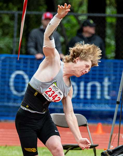 LON AUSTIN/CENTRAL OREGONIAN - Jason Slawter played football, ran cross country and competed in track & field during his four years at CCHS. Slawter, who is shown throwing the javelin at this year's state meet, where he placed seventh, was named CCHS Booster Club athlete of the year runner-up at the Booster Club's awards banquet this past Saturday.