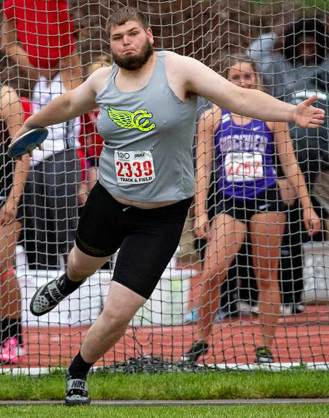 LON AUSTIN/CENTRAL OREGONIAN - Caleb Parrott throws the discus at the state track & field championships. Parrott had a personal best throw at the meet, to finish in eighth place. Parrott competed in football, wrestling, and track & field during his four years at Crook County High School. As a heavyweight, Parrott placed at state multiple years in wrestling. A two-time state meet performer in track & field, he was also selected to the Intermountain Conference all-league team as a lineman in football. His senior year, Parrott was a team captain in all three sports. Parrott was named the male athlete of the year at this year's Crook County High School Booster Club Awards Banquet.