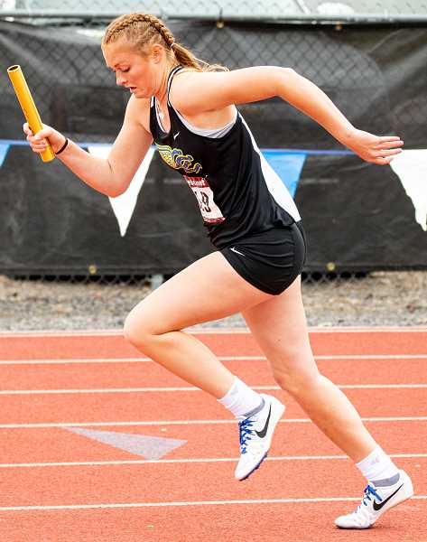 LON AUSTIN/CENTRAL OREGONIAN - Gracie Kasberger comes out of the blocks for the start of the 4x400-meter relay during the Intermountain Conference track championships. Kasberger, who competed in soccer, cross country, basketball, and track & field during her four years at CCHS, missed most of this year with a knee injury suffered during the soccer season.  Kasberger worked hard to rehab her knee and stayed involved with her teams the entire year, finally returning to action late in the track season. The CCHS relay squad went on to win the conference title and finish seventh at the state meet. Kasberger was named female athlete of the year at this year's Crook County High School Booster Club Awards Banquet