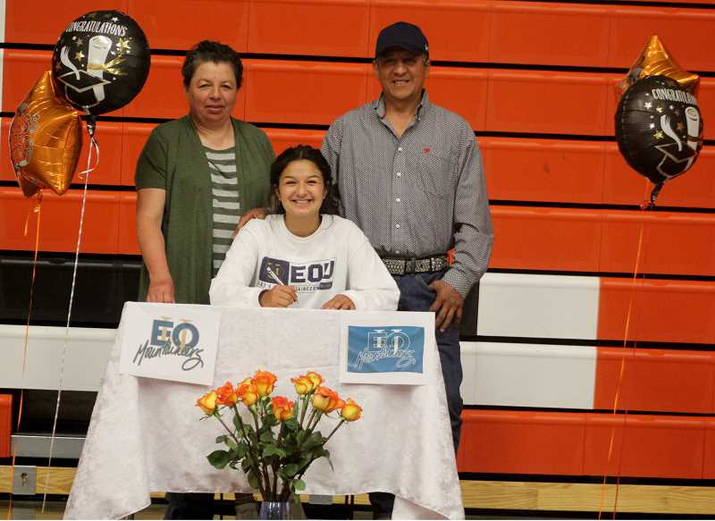 STEELE HAUGEN - Irma Retano commits to playing basketball at Eastern Oregon University, in La Grande, next to parents Irma Rodriguez and Jesus Retano Sr.