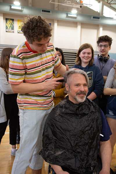 COURTESY PHOTO: CHARLIE HYMAN - WHS teacher Christopher Shotola-Hardt gets his head shaved during the Doernbecher's assembly.