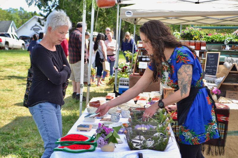 PMG PHOTO: BRITTANY ALLEN - Blue Raven Pottery has wares for sale every Friday at the Mount Hood Farmers Market from 3-7 p.m.