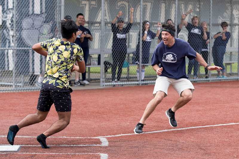 PMG PHOTO: JAIME VALDEZ - Aaron Mancilla-Ramos chases Wilsonville High School boys' soccer coach Ian Reschke during a game of kickball during Doernbecher Days at the high school.