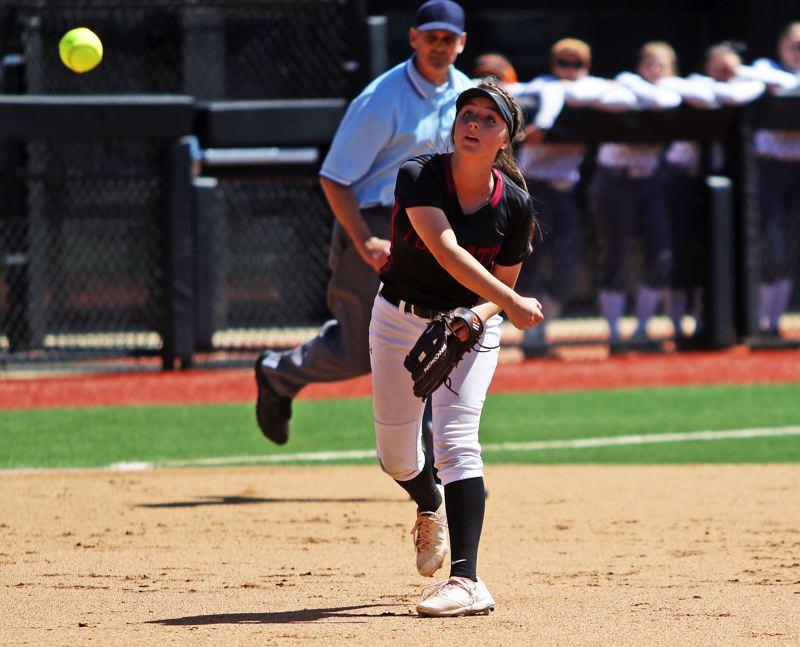 PMG PHOTO: DAN BROOD - Tualatin High School junior Bella Valdes makes a throw to first base during Saturday's Class 6A state championship game. Valdes made her return to shortstop during the title contest.
