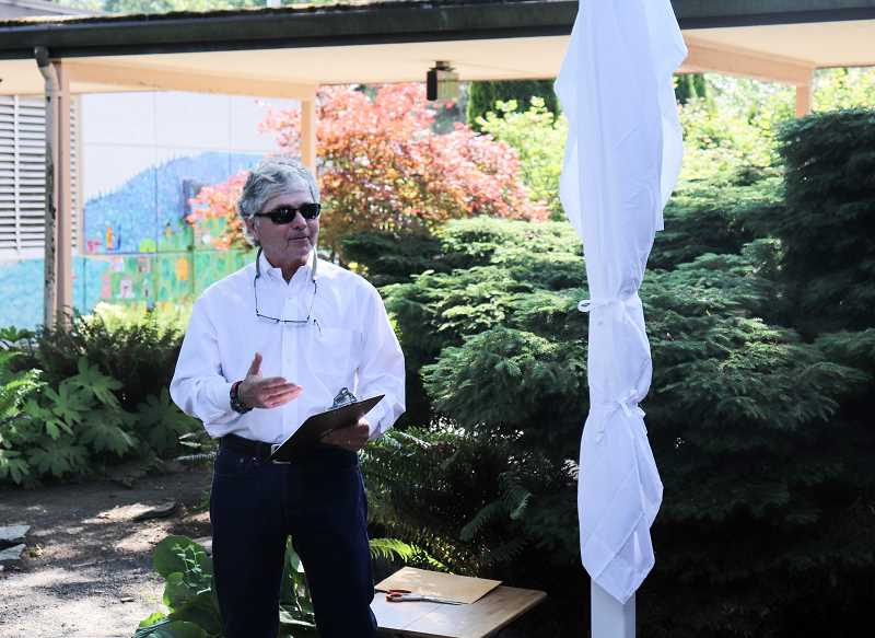 COURTESY PHOTO: ANDREW KILSTROM - West Linn Rotarian David Goode welcomes community members and provides a history on the Peace Pole.
