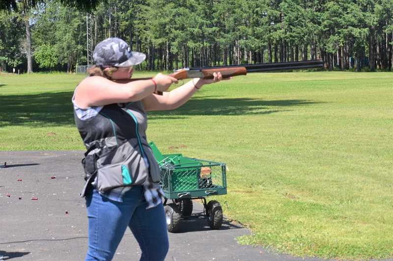 PMG PHOTO: EMILY LINDSTRAND - Amber Haggstrom was one of the Girl Scouts who earned her clay target shooting badge at Douglas Ridge Rifle Club last weekend.