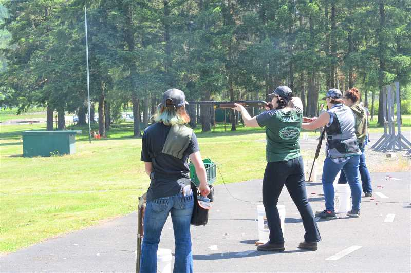 PMG PHOTO: EMILY LINDSTRAND - Emily Hall shoots at Douglas Ridge Rifle Club as she earns her clay target shooting badge.