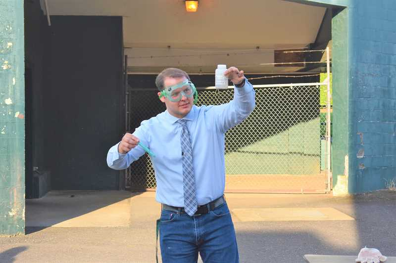 PMG PHOTO: EMILY LINDSTRAND - Estacada Middle School Principal Ben Hargrave prepares for a demonstration during the schools science night.