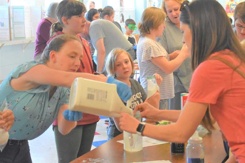 PMG PHOTO: EMILY LINDSTRAND - Creating slime was one of several popular activities at Estacada Middle Schools science night on Thursday, May 30.