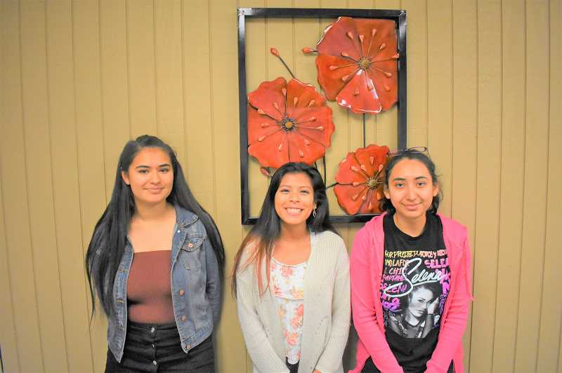 PMG PHOTO: EMILY LINDSTRAND - Estacada High School seniors Victoria Martinez, Cindy Ucan and Noemi Castrejon earned the Oregon State Seal of Biliteracy