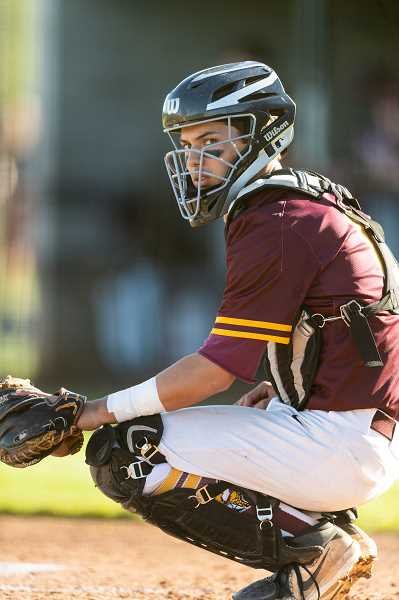 PMG PHOTO: CHRISTOPHER OERTELL - Forest Grove's Max Richards during a game this past season. Richards was selected as a unanimous Pacific Conference first team catcher.