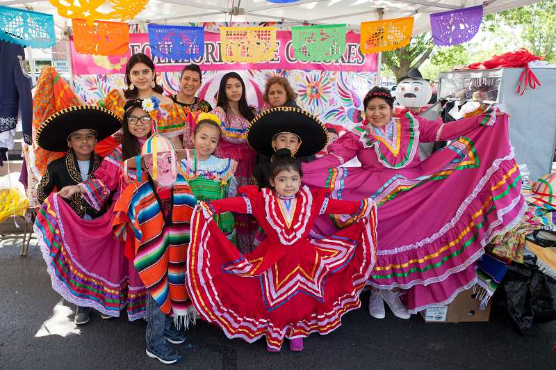PMG PHOTO: JAIME VALDEZ - Baile Folkloric De Colores dancers pose for a picture wearing traditional Mexican costumes. 0605-WSPNE-Art Fest Wild006--The Steal the Sun Tai Chi group performs at the Wilsonville Festival of the Arts.