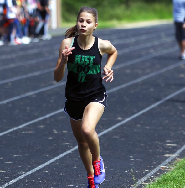 PMG PHOTO: DAN BROOD - Fowler's Lily Herman won the eighth-grade girls race at the Beadnell Classic mile run. It's the third straight year she's triumphed at the event.