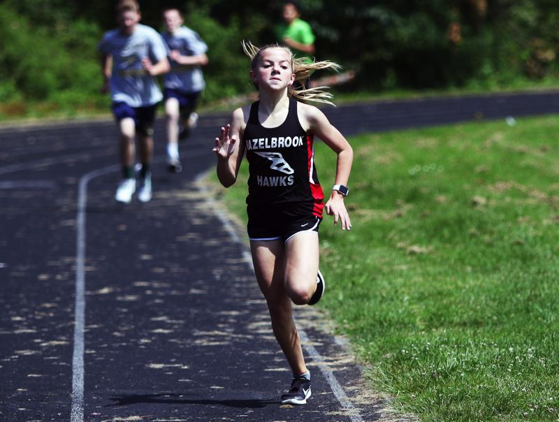 PMG PHOTO: DAN BROOD - Hazelbrooks'  Lauren Ayers was the overall winner of the seventh-grade race at the Beadnell Classic mile run held at Fowler Middle School.