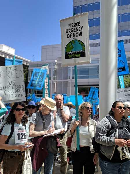 PMG PHOTO: COURTNEY VAUGHN - Participants in a rally to support a youth climate lawsuit against the federal government gather in downtown Portland Tuesday, June 4 shortly before court hearings on the lawsuit were scheduled to take place.