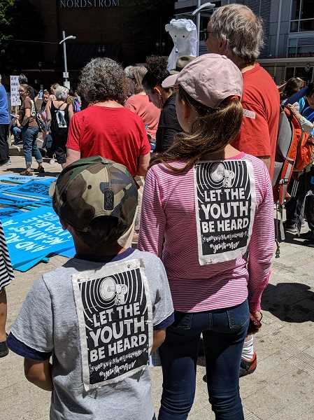 PMG PHOTO: COURTNEY VAUGHN - Angel Montes, 10, and Sophia Asturino, 11, gather in Director Park for a rally to support young plaintiffs in a lawsuit against the federal government over climate change.