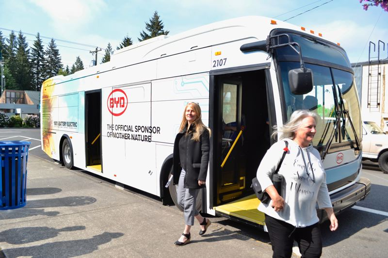 PMG PHOTO: BRITTANY ALLEN - Past Sandy Transit Director Julie Stephens and current Director Andi Howell were among the riders to demo the BYD electric bus on Wednesday, May 29.