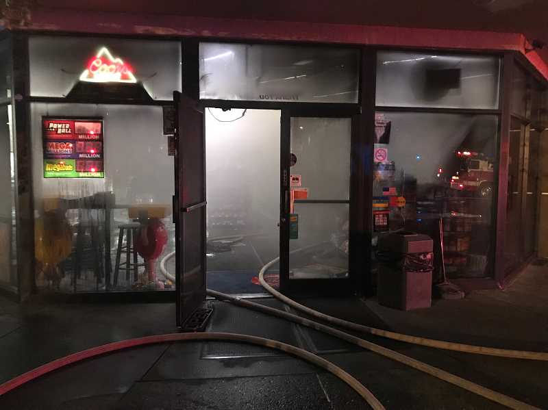 COURTESY TVF&R - Fire caused extensive damage to a convenience store that was part of a gas station in the 7000 block of Nyberg Street on early