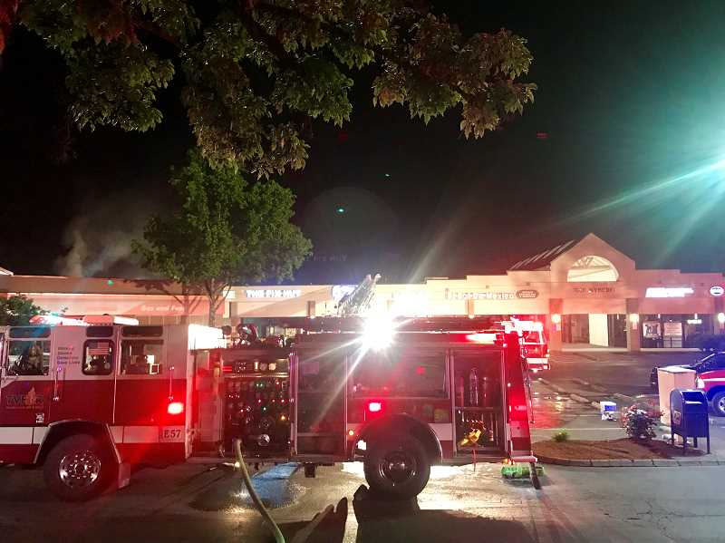 COURTESY TVF&R - The convenience store fire was isolated to one business with some smoke damage occurring to adjoining businesses. It was brought under control at 2:08 a.m.