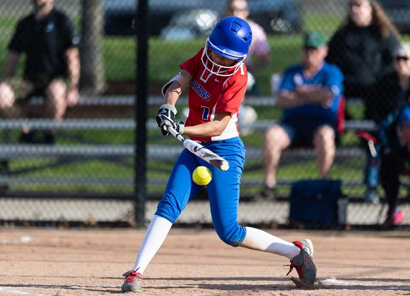 PMG PHOTO: CHRISTOPHER OERTELL - Hillsboro's Kiara McCrea takes a swing during a game this past season. McCrea was a first team all-league selection for the Spartans.