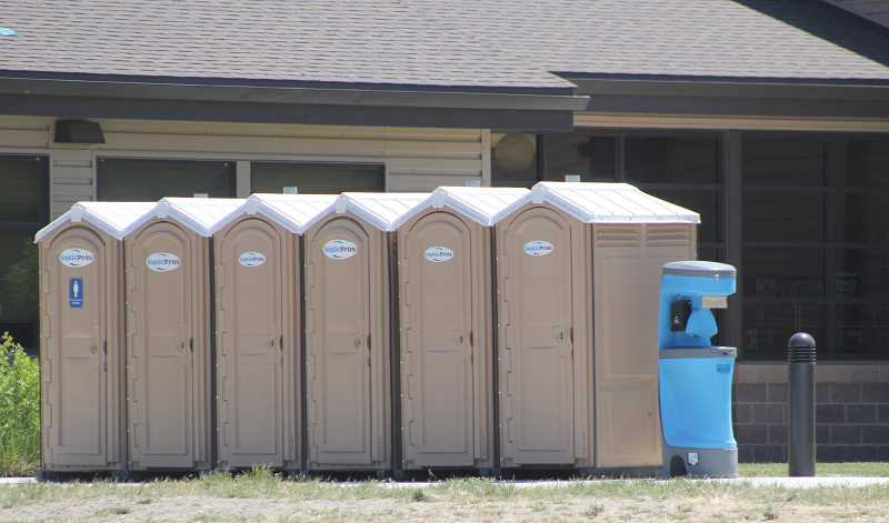 STEELE HAUGEN/MADRAS PIONEER - Due to a break in a main water line on the Warm Springs Reservation, Warm Springs K-8 Academy closed on Thursday and Friday, but reopened on Monday. On Tuesday, port-a-potties remain lined up outside the school, as a precaution, even though the school had water pressure restored.