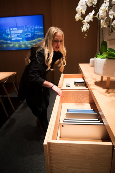 PMG: JAIME VALDEZ - A manager at Apple Pioneer Place, shows off the drawers of loaner product in the new Boardroom, where business clients and big spenders can get hands-on demonstrations.