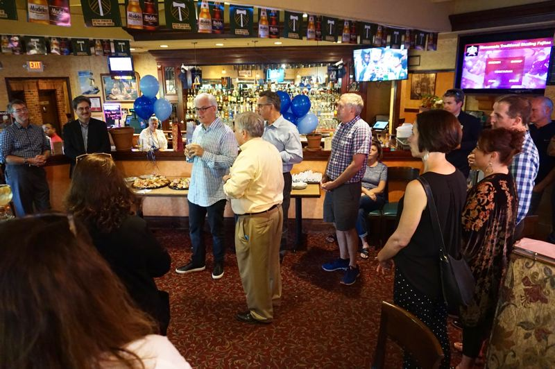 PMG PHOTO: CLAIRE HOLLEY - School board chair Bob Barman toasts Michael Musick at his farewell celebration last week.