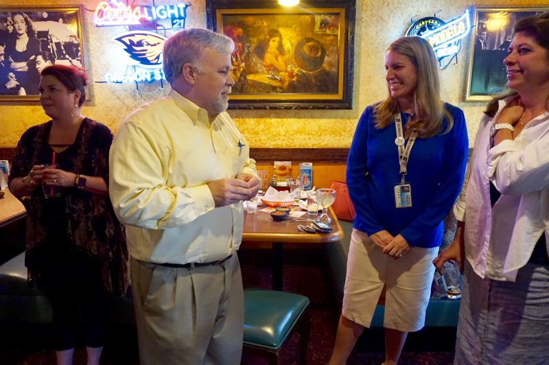 PMG PHOTO: CLAIRE HOLLEY - Michael Musick chats with assistant superintendent Jennifer Schiele and school board secretary Kelli Cranston at his goodbye party.