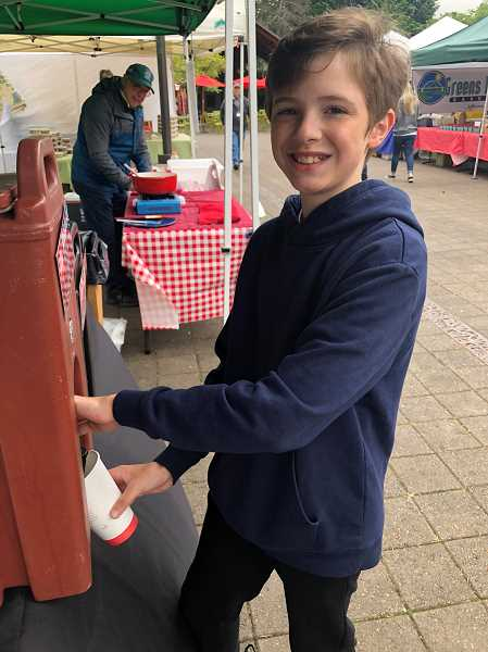 Mac Shaw Ryan is the youngest vendor at the Lake Oswego Farmers' Market. Stop by and get coffee from him each Saturday from 8:30 to 11 a.m.