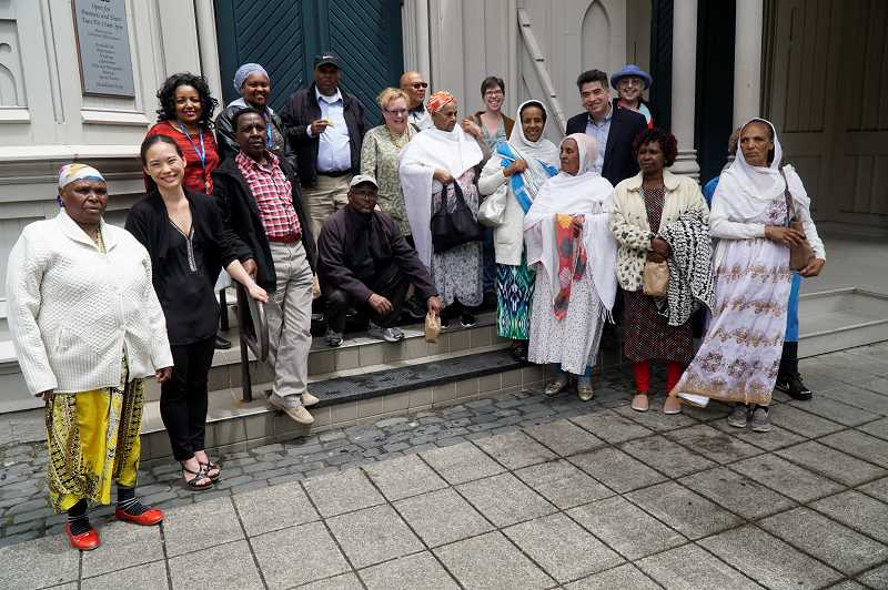 COURTESY PHOTO - This photo was taken June 14, 2018, following the Worldwide Welcome bonus concert presented by Fear No Music. Fear No Music Executive Director Monica Ohichu, second from left, and Artistic Director Kenji Bunch, second row, second from right, pose with audience members from the immigrant and refugee community organization Africa House.