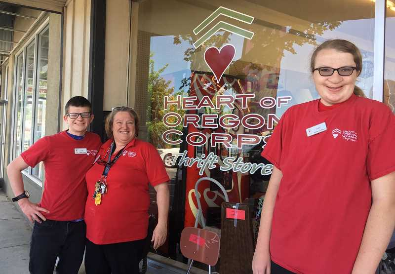 SUBMITTED PHOTO - Heart of Oregon Thrift Store manager Linda Graham is surrounded by Tyler and Sara, employees of the Thrift Store, who have been busy, along with the other employees, prepping for a remodel at the store. A main part of the remodel will be new flooring.