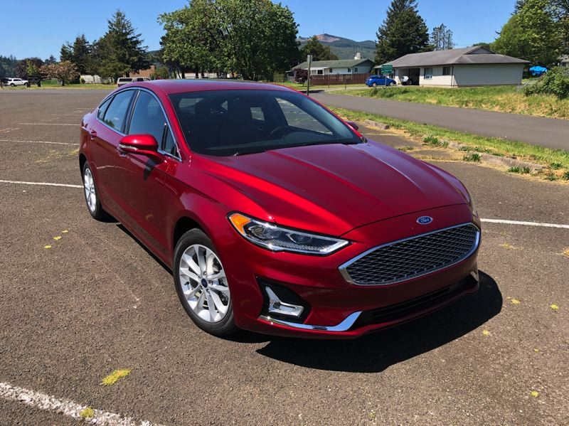 PMG PHOTO: JEFF ZURSCHMEIDE - The 2019 Ford Fusion Energi is a stylish mid-size sedan that drives well and gets remarkable fuel economy.