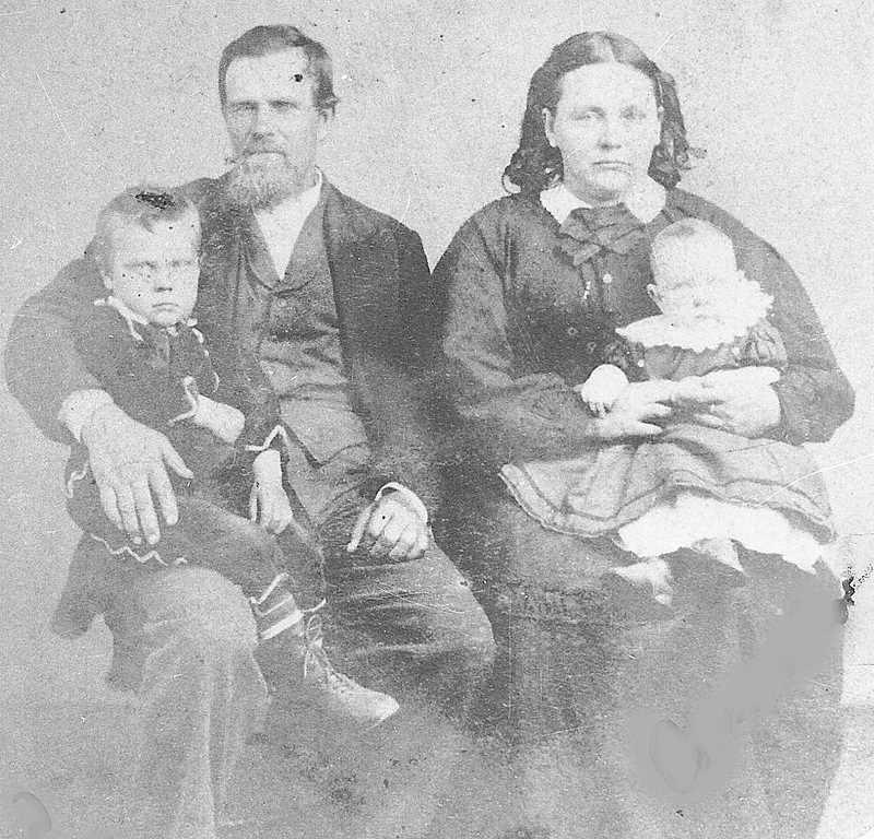 PHOTO COURTESY OF BOWMAN MUSEUM - Samuel and Margaret Carroll pose for a family photo. Their children became prominent residents in the area.