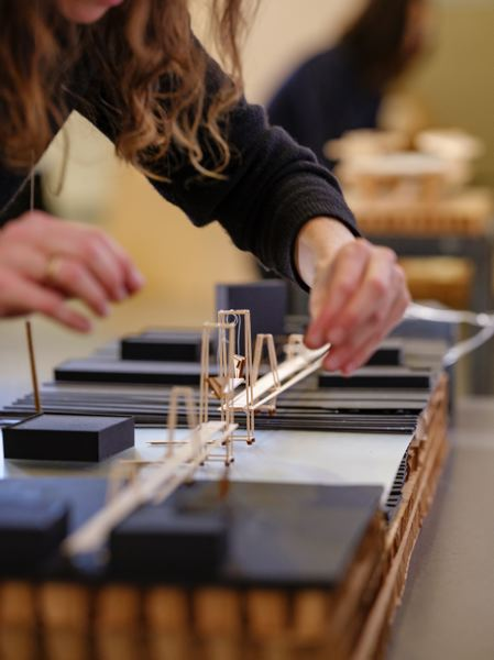 COURTESY: PORTLAND STATE UNIVERSITY - An architecture student works on a 3-D model for a graduate studio class at Portland State University that asked students to come up with designs for a seismiscally updated Burnside Bridge.