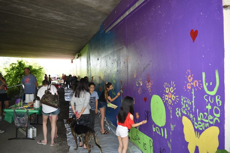 PMG PHOTO: MATT DEBOW  - Attendees put their personal touches on a community mural in Fairview.