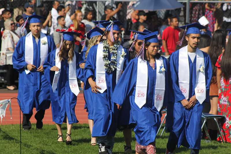 STEELE HAUGEN/MADRAS PIONEER - Bridges High School students, part of the 509-J School District graduates, include from back left to right, Ruiben Gonzalez, DzJiana Enriquez, Richayla Elliott, Aram David, Samantha Culps, Caramiah Charley, and Victor Calixtro. Bridges graduated 51 students.
