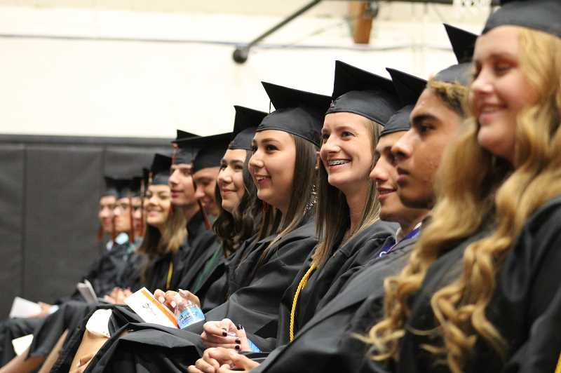 DESIREE BERGSTROM/MADRAS PIONEER - Culver High School seniors, from front right to left, Addison Finley, Erick Vega, Lorenzo Vasquez, Mikayla Haessler, Ryanne Scholl, and Ayla Turbyfill listen to speakers during their graduation ceremony June 1.