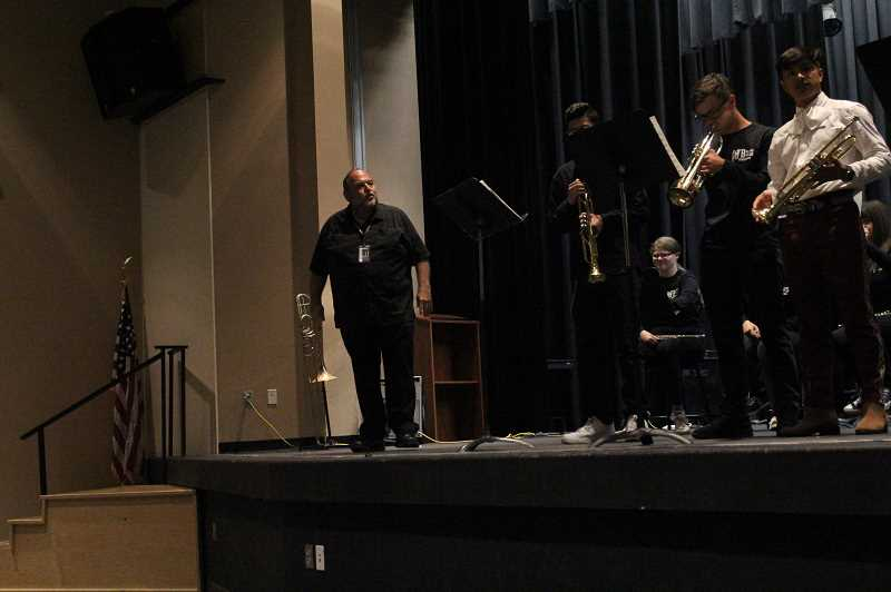 PMG PHOTO: JUSTIN MUCH - Woodburns longtime band teacher Brian Gingrich showcases the trumpet section during the schools Spring Band Concert.