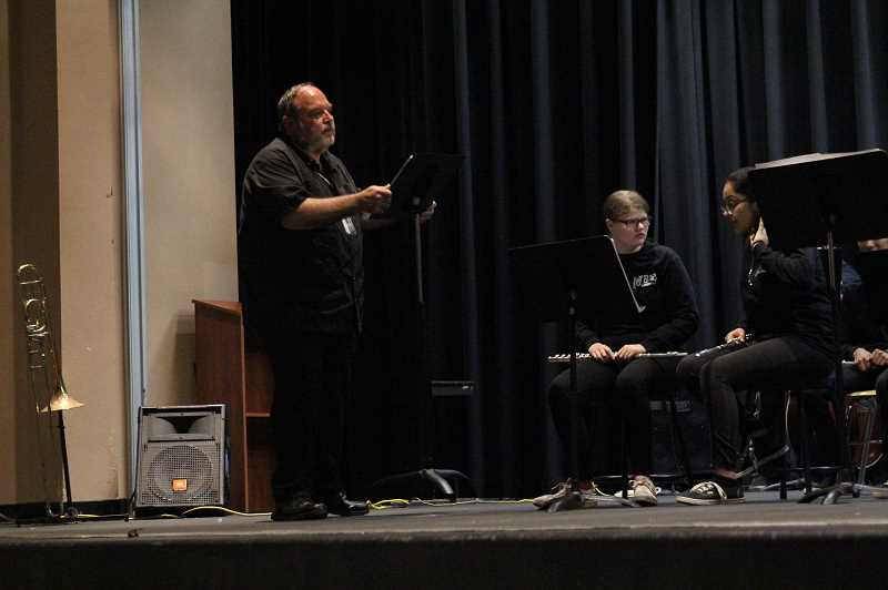 PMG PHOTO: JUSTIN MUCH - Woodburn's longtime band teacher Brian Gingrich directs the students during the schools Spring Band Concert.